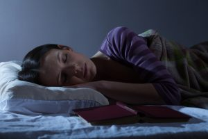 Young woman is sleeping in her bed.